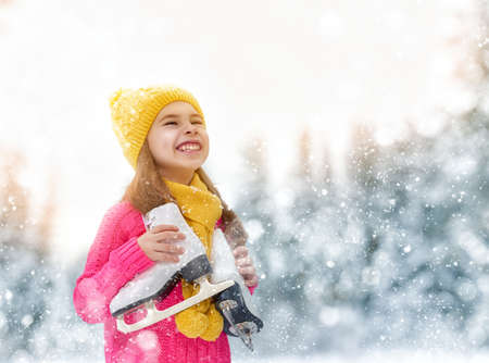 snow  ice: cute little girl is going skate outdoors