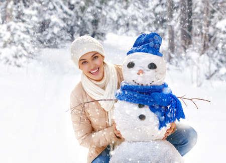 winter holiday: Happy young woman on a winter walk in nature.