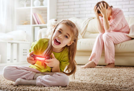 frustrating: mother frustrating that her child playing video games
