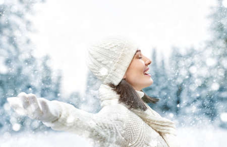 lifestyle outdoors: Happy young woman on a winter walk in nature.