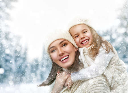 happy family nature: Happy family! Mother and child girl on a winter walk in nature. Stock Photo