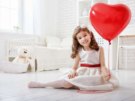 sweet heart: Happy Valentines Day! Sweet child girl with red heart.