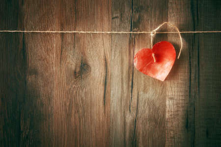 paper heart on wooden background. the concept of love and Valentine's day.