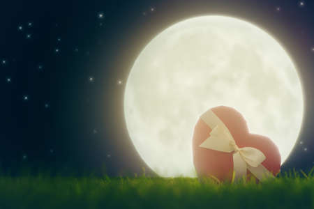 fairytale: red gift box in shape of heart on the background of a moon. the concept of love and Valentines day.