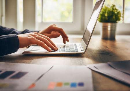businessman using laptop computer sitting working office. Standard-Bild