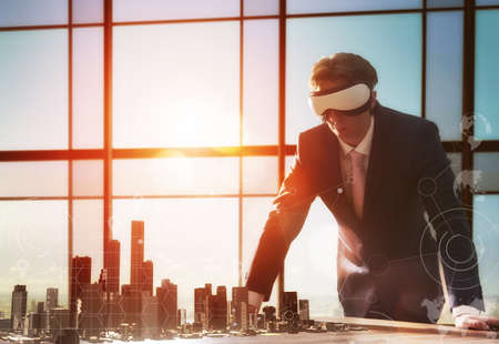 technological: businessman developing a project using virtual reality goggles. the concept of technologies of the future