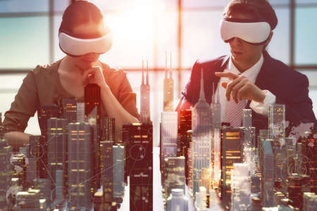 innovation: two business persons are developing a project using virtual reality goggles. the concept of technologies of the future