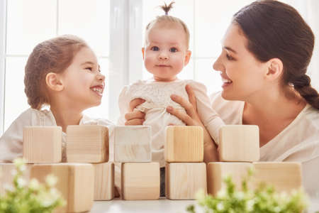 family playing: Happy loving family playing with blocks and having fun.