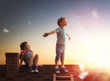 happy childhood! boy and girl playing on the roof.