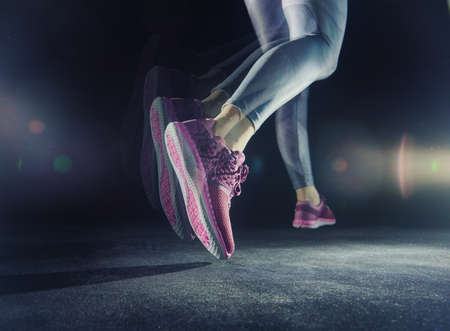 woman running: athletes foot close-up. healthy lifestyle and sport concepts. Stock Photo