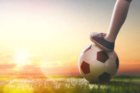 dream: Cute little child dreams of becoming a soccer player. Child plays football.