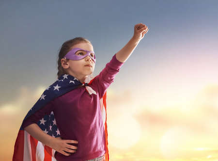 american hero: Patriotic holiday. Happy kid, cute little child girl with American flag. USA celebrate 4th of July.