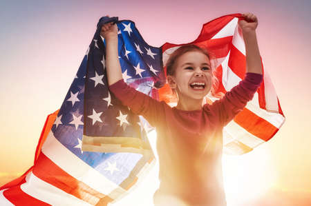 usa: Patriotic holiday. Happy kid, cute little child girl with American flag. USA celebrate 4th of July.