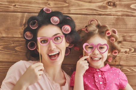 Funny family! Mother and her child daughter girl with a paper accessories. 写真素材