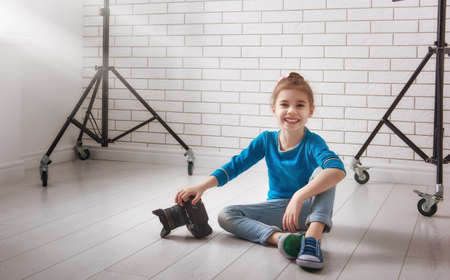 equipping: Cute little child girl in photo Studio