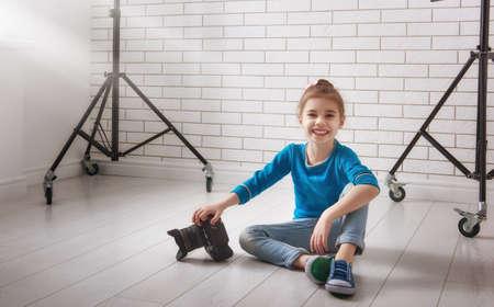photo studio: Cute little child girl in photo Studio