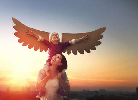 Mother and her daughter child playing together. Little girl plays in the bird. Happy loving family having fun. Stock Photo - 62740691
