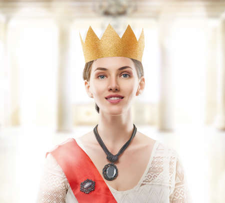 primp: Young beautiful woman in a Golden crown