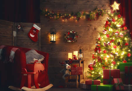 night background: Happy Holiday! A beautiful living room decorated for Christmas.
