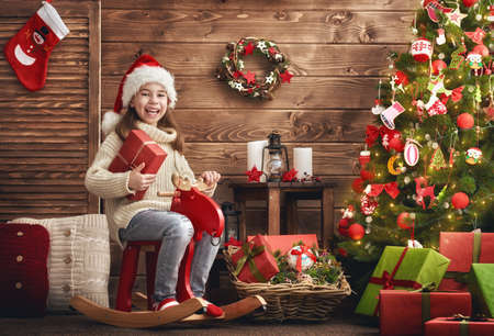 Merry Christmas and Happy Holiday! Cute little child girl on Christmas. Reklamní fotografie