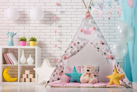 wall decor: Spacious children room with play tent for girl.
