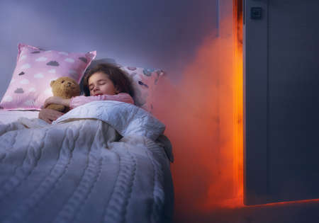 Nightmare for children. Little child girl is afraid of monsters in the dark of night. Фото со стока - 69994303