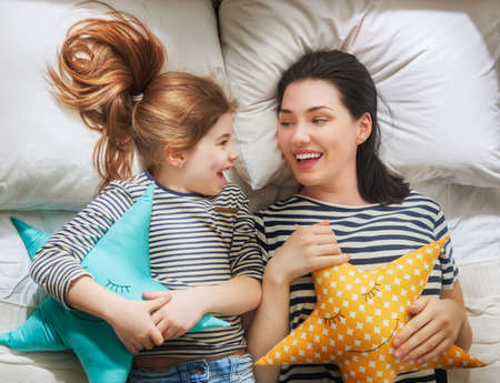 Happy mother's day! Mom and her daughter child girl are playing and smiling. Family holiday and togetherness. Imagens - 75653794