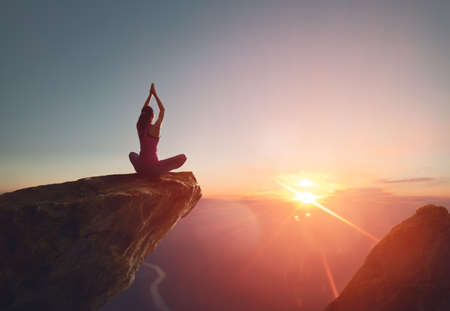 Woman practices yoga and meditates on the mountain. Stock fotó - 82623100