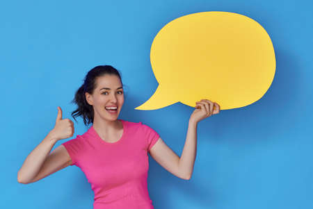 Beautiful young woman with cartoon speech on colorful background. Yellow, pink and blue colors.