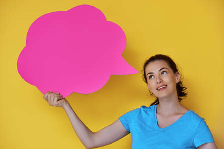 Beautiful young woman with cartoon thought on colorful background. Yellow, pink and blue colors. photo