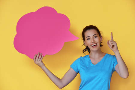 thought balloon: Beautiful young woman with cartoon thought on colorful background. Yellow, pink and blue colors.