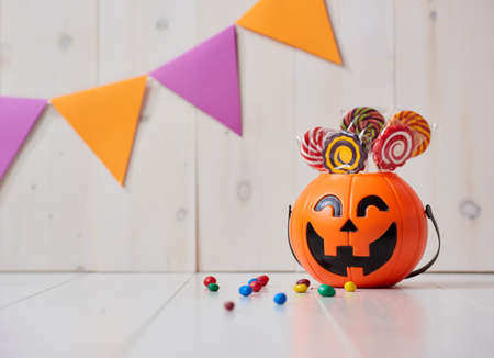 Happy halloween! Pumpkin with candy in the home. Stock Photo