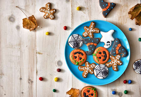 Happy Halloween! Festive sweets and cookies on the table in the home. Preparation for holiday.