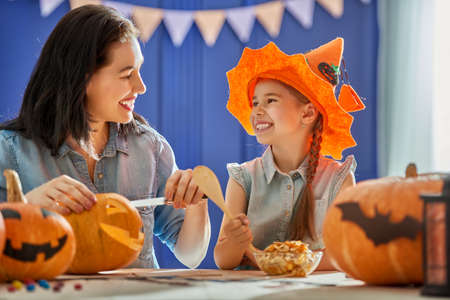 Mother and her daughter having fun at home. Happy Family preparing for Halloween. Stock fotó - 87327444