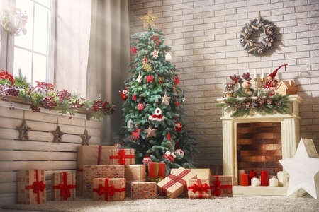 Merry Christmas and Happy New Year! A beautiful living room decorated for holidays.