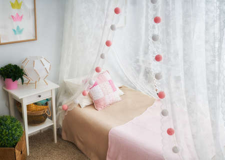 Interior of light kids bedroom for child girl. 写真素材