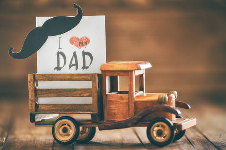 Happy father's day! Postcard on background of wooden table. Archivio Fotografico