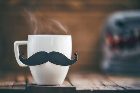 Happy father's day! Cup of coffee on background of wooden table. Archivio Fotografico