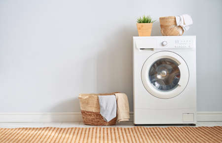 Interior of a real laundry room with a washing machine at home Standard-Bild - 118648120