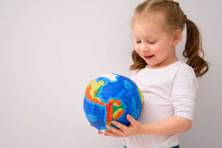 Child with globe. Happy Earth day.