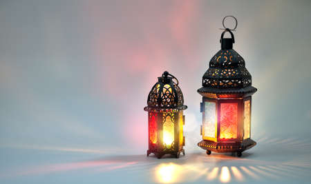 Ornamental Arabic lantern with burning candle glowing on white background. Festive greeting card, invitation for Muslim holy month Ramadan Kareem. Archivio Fotografico - 119476786