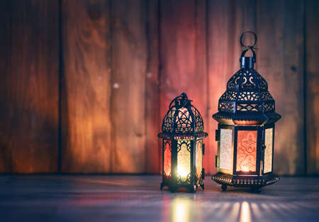 Ornamental Arabic lantern with burning candle glowing at night. Festive greeting card, invitation for Muslim holy month Ramadan Kareem. Standard-Bild - 120575281