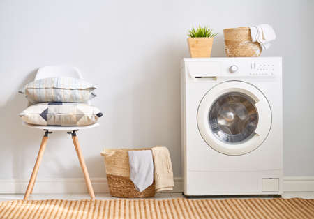 Interior of a real laundry room with a washing machine at home Imagens - 120575283