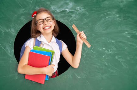 Back to school! Happy cute industrious child indoors. Stock Photo - 128344719