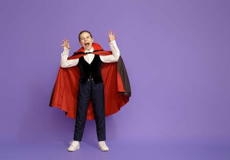 Happy Halloween! Cute little Dracula on purple background.