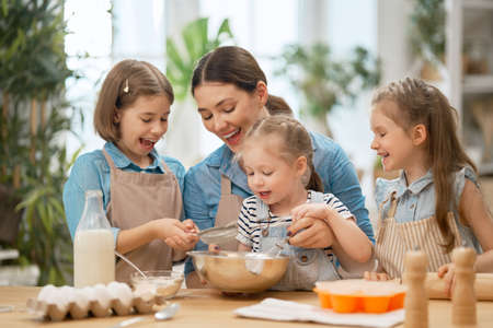 Happy loving family are preparing bakery together.