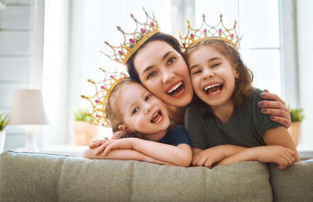 Happy loving family. Mother and her daughter child girl playing and hugging at home. Stock Photo