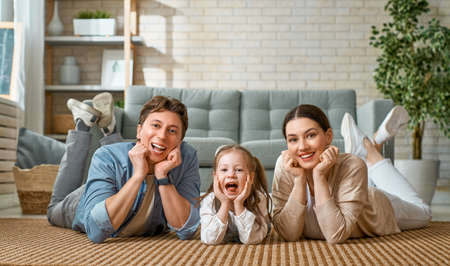 Happy family! Child daughter with mother and father. Mum, dad and girl laughing and hugging.