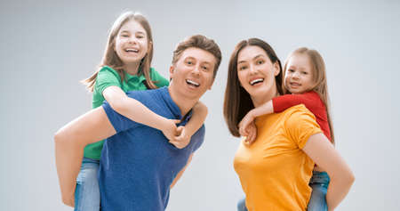 Happy loving family. Mother, father and children daughters on white background.