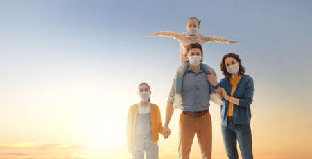 Family is wearing facemasks during coronavirus and flu outbreak. Virus and illness protection, quarantine. COVID-2019. Take on or take off masks.